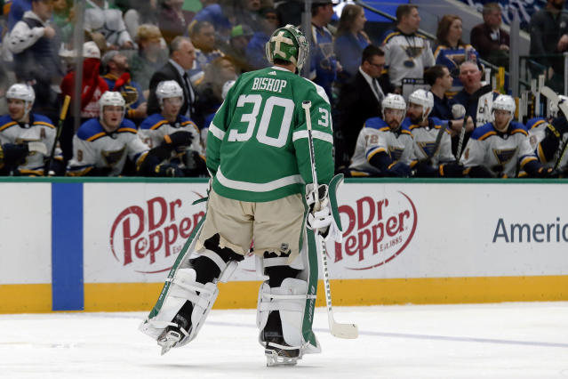 Dallas Stars goaltender Ben Bishop skates for the bench after being pulled, having given up four goals to the St. Louis Blues, during the second period of an NHL hockey game in Dallas, Friday, Feb. 21, 2020. (AP Photo/Ray Carlin)