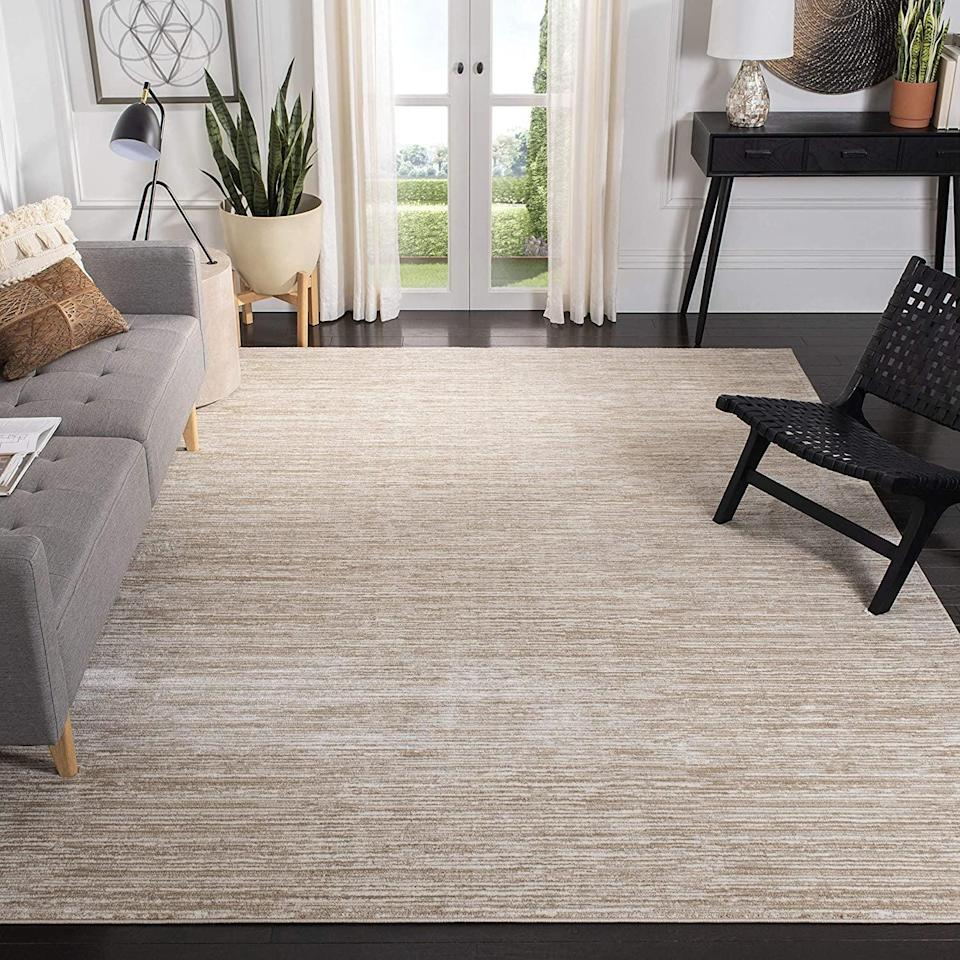 <p>This <span>Safavieh Vision Collection Modern Contemporary Ombre Chic Area Rug</span> ($26-$414) is the perfect modern piece without being over the top.</p>