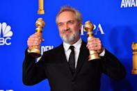 """British film director Sam Mendes poses in the press room with his two Golden Globes for war epic """"1917"""""""
