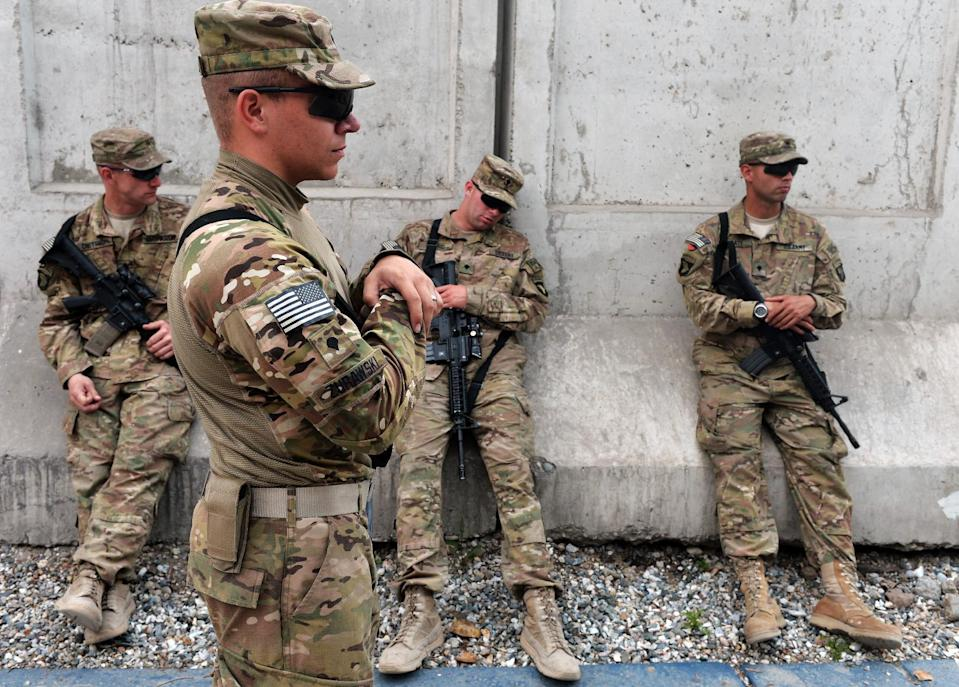 US soldiers take a break after an award ceremony at Forward Operating Base, Finley Shields in Jalalabad in Nangarhar province on April 6, 2013 (AFP Photo/Manjunath Kiran)