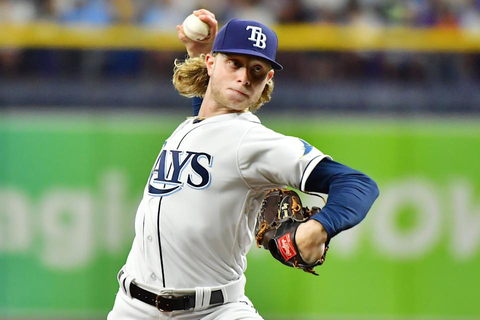 ST PETERSBURG, FLORIDA - SEPTEMBER 20: Shane Baz #11 of the Tampa Bay Rays delivers a pitch to the Toronto Blue Jays in the third inning at Tropicana Field on September 20, 2021 in St Petersburg, Florida. (Photo by Julio Aguilar/Getty Images)