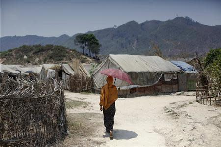 A Rohingya woman walks at the Kyein Ni Pyin camp for internally displaced people in Pauk Taw, Rakhine state
