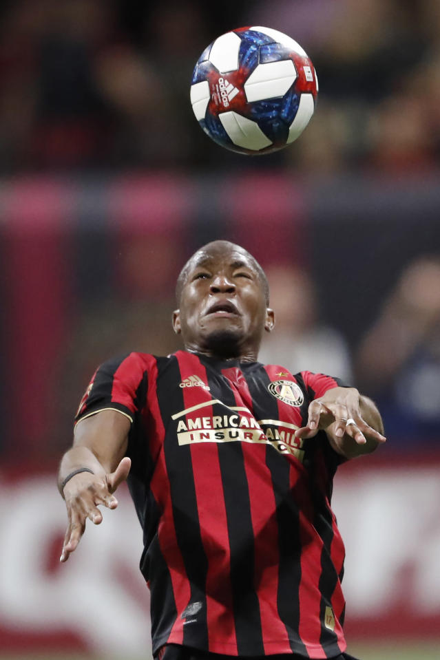 Atlanta United midfielder heads the ball during the first half of against the Philadelphia Union in an MLS soccer Eastern Conference semifinal Thursday, Oct. 24, 2019, in Atlanta. (AP Photo/John Bazemore)