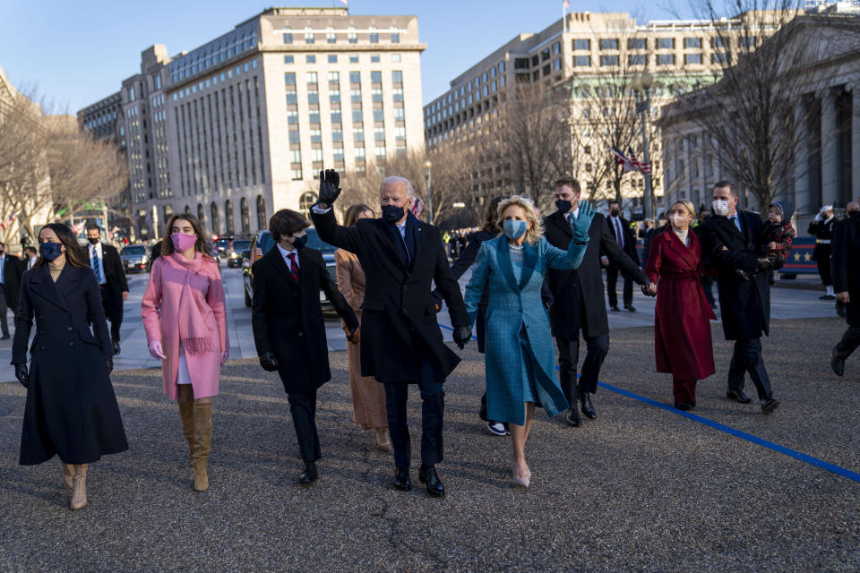 President Joe Biden, First Lady Jill Biden and family, walk near the White House during a Presidential Escort to the White House, Wednesday, Jan. 20, 2021 in Washington. (Doug Mills/The New York Times via AP, Pool)