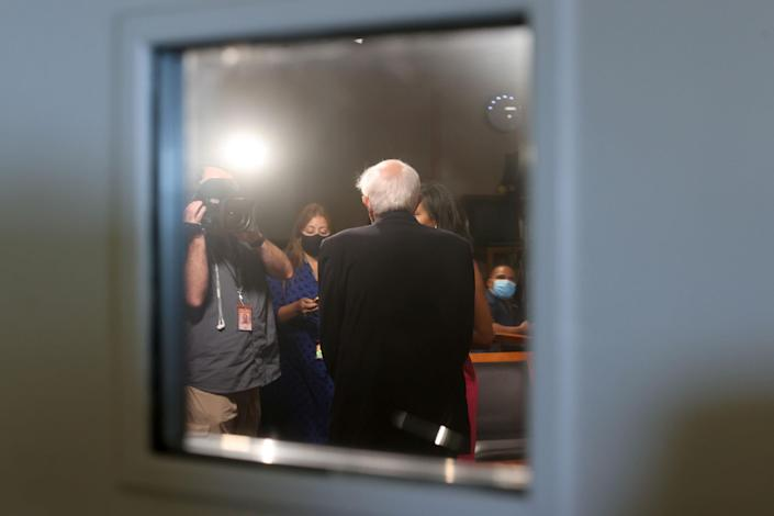 """Sanders takes time for a television interview between votes on the Senate floor prior to passage of a $1 trillion bipartisan infrastructure bill on Aug. 10.<span class=""""copyright"""">Jonathan Ernst—Reuters</span>"""