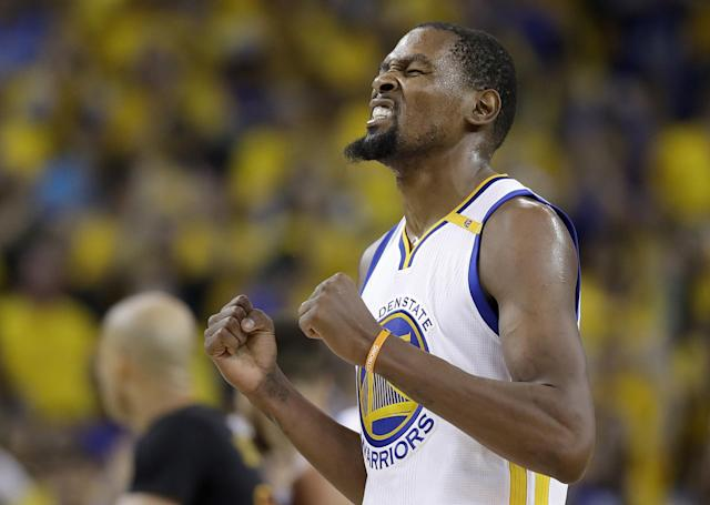 """<a class=""""link rapid-noclick-resp"""" href=""""/nba/players/4244/"""" data-ylk=""""slk:Kevin Durant"""">Kevin Durant</a> is a champion in his first season with the Warriors. (AP)"""
