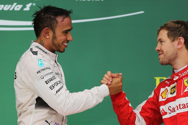 File photo dated 25-10-2015 of Mercedes' Lewis Hamilton shakes hands with Ferrari's Sebastian Vettel (right) after his victory and winning the 2015 Formula One World Championship in the United States Grand Prix at the Circuit of The Americas in Austin, Texas, USA.