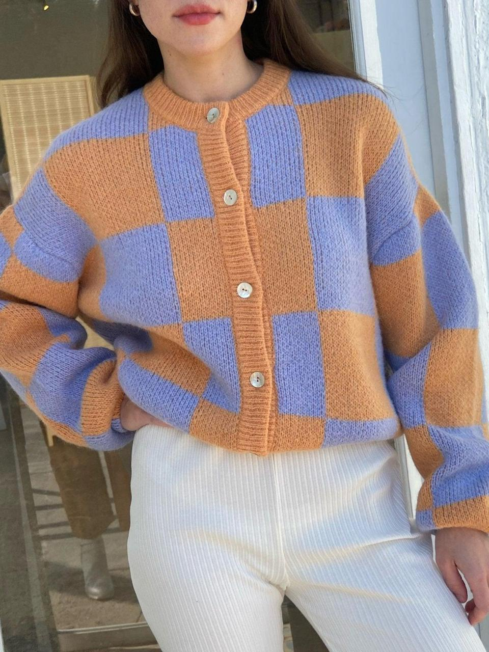 """<br><br><strong>Stine Goya</strong> Ash Cardigan Sweater, $, available at <a href=""""https://go.skimresources.com/?id=30283X879131&url=https%3A%2F%2Flisasaysgah.com%2Fcollections%2Fsweaters%2Fproducts%2Fash-cardigan-sweater-1213-checks-1"""" rel=""""nofollow noopener"""" target=""""_blank"""" data-ylk=""""slk:Lisa Says Gah"""" class=""""link rapid-noclick-resp"""">Lisa Says Gah</a>"""