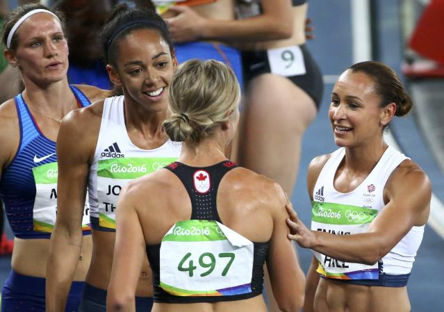 2016 Rio Olympics - Athletics - Final - Women's Heptathlon 800m - Olympic Stadium - Rio de Janeiro, Brazil - 13/08/2016. Jessica Ennis-Hill (GBR) and Katarina Johnson-Thompson (GBR) of Britain and Brianne Theisen-Eaton (CAN) of Canada celebrate after the race REUTERS/David Gray FOR EDITORIAL USE ONLY. NOT FOR SALE FOR MARKETING OR ADVERTISING CAMPAIGNS.