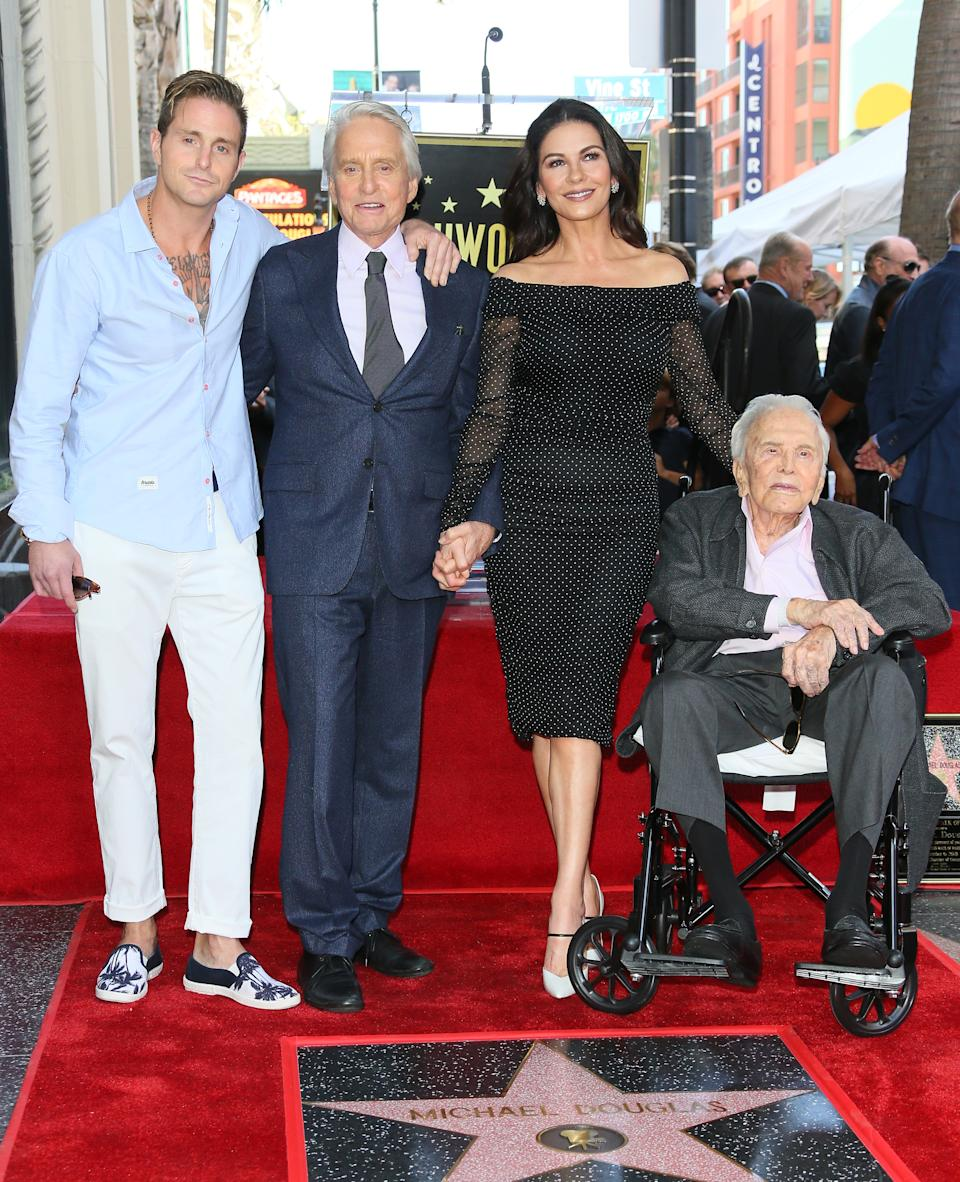 Cameron Douglas, Michael Douglas, Kirk Douglas and Catherine Zeta-Jones pose at the Michael Douglas Star On The Hollywood Walk Of Fame ceremony on November 6, 2018 in Hollywood, California. (Photo by JB Lacroix/WireImage)