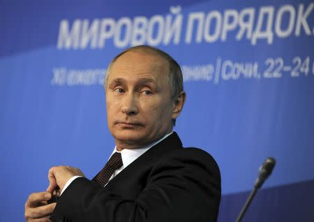 Russia's President Vladimir Putin attends a meeting at the Valdai Discussion Club in Sochi