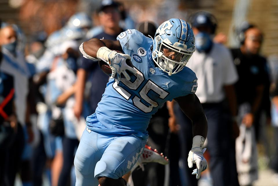 Javonte Williams was a freight train against North Carolina State on Saturday. (Photo by Grant Halverson/Getty Images)
