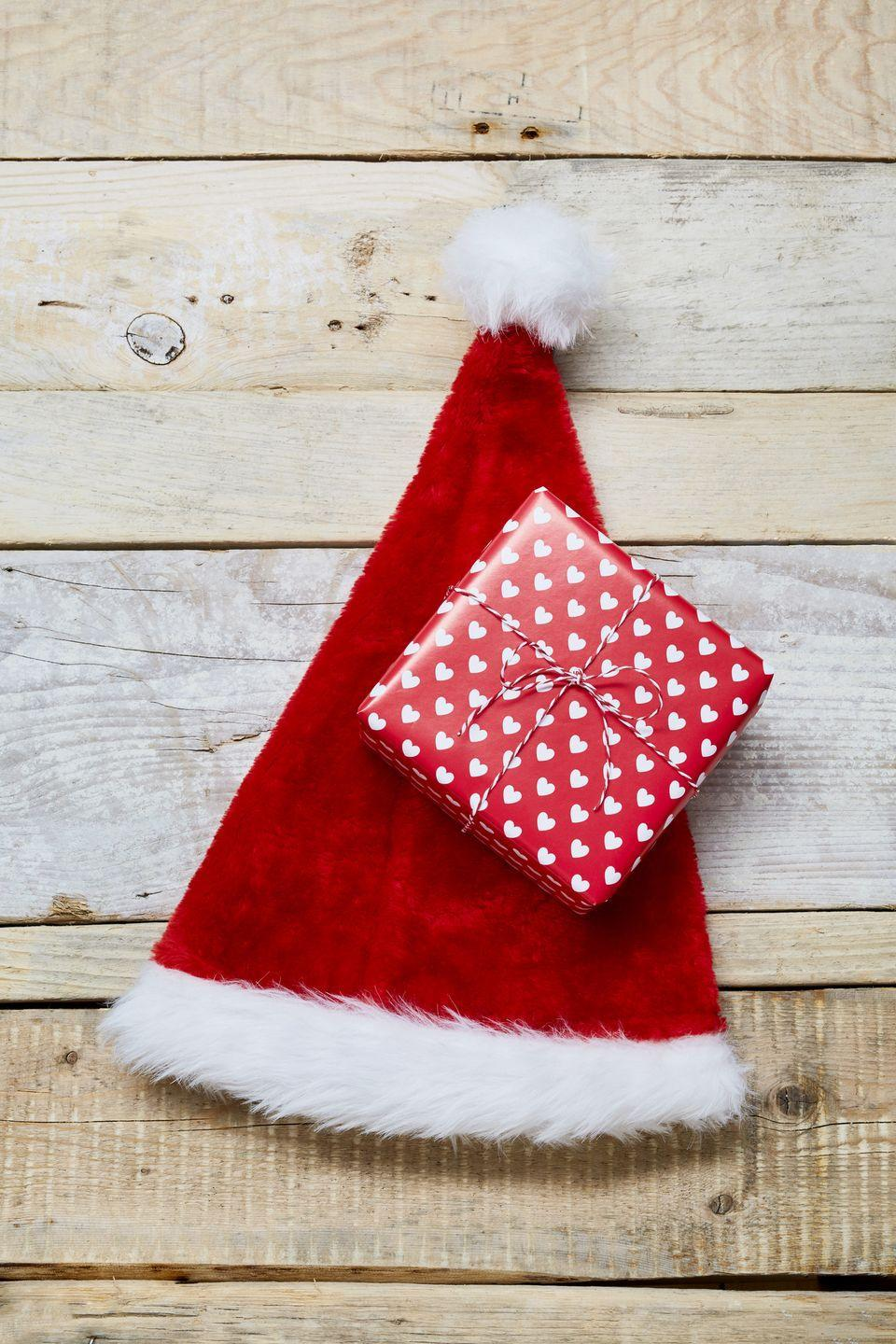 """<p>At the beginning of the party, each person is given a Santa hat and a piece of paper. However, only one person is """"it"""" and whenever they take their hat off, everyone else must follow suit. The last person with their hat on loses. </p><p><strong><a class=""""link rapid-noclick-resp"""" href=""""https://www.amazon.com/BALORAY-Adults-Comfort-Double-Velvet/dp/B07DCVM6H1/?tag=syn-yahoo-20&ascsubtag=%5Bartid%7C10050.g.22718533%5Bsrc%7Cyahoo-us"""" rel=""""nofollow noopener"""" target=""""_blank"""" data-ylk=""""slk:SHOP SANTA HATS"""">SHOP SANTA HATS</a><br></strong></p>"""