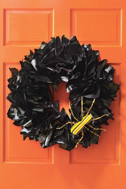 """<p>A shiny black wreath fashioned out of spray-painted newspaper is a clever — and easy — way to welcome trick-or-treaters.<br></p><p><a href=""""https://www.womansday.com/home/crafts-projects/how-to/a5941/craft-project-newspaper-wreath-123858/"""" rel=""""nofollow noopener"""" target=""""_blank"""" data-ylk=""""slk:Get the tutorial for Newspaper Halloween Wreath."""" class=""""link rapid-noclick-resp""""><em>Get the tutorial for Newspaper Halloween Wreath.</em></a></p><p><strong>What you'll need:</strong> <a href=""""https://www.amazon.com/KINGLAKE-Christmas-Industrial-Materials-Applications/dp/B00WHXQIJA?tag=syn-yahoo-20&ascsubtag=%5Bartid%7C10070.g.2488%5Bsrc%7Cyahoo-us"""" rel=""""nofollow noopener"""" target=""""_blank"""" data-ylk=""""slk:Twine"""" class=""""link rapid-noclick-resp"""">Twine</a> ($6, Amazon); <a href=""""https://www.amazon.com/eBoot-Floral-Gauge-Pieces-Green/dp/B01FGV1FXI?tag=syn-yahoo-20&ascsubtag=%5Bartid%7C10070.g.2488%5Bsrc%7Cyahoo-us"""" rel=""""nofollow noopener"""" target=""""_blank"""" data-ylk=""""slk:Floral wire"""" class=""""link rapid-noclick-resp"""">Floral wire</a> ($7, Amazon)<br></p>"""