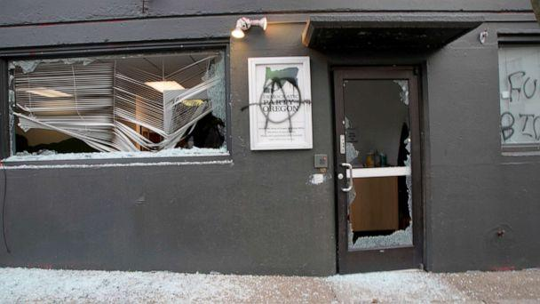 PHOTO: A group of protesters damaged the headquarters of the Democratic Party of Oregon in Portland on Jan. 20, 2021. (Beth Nakamura/The Oregonian via AP)