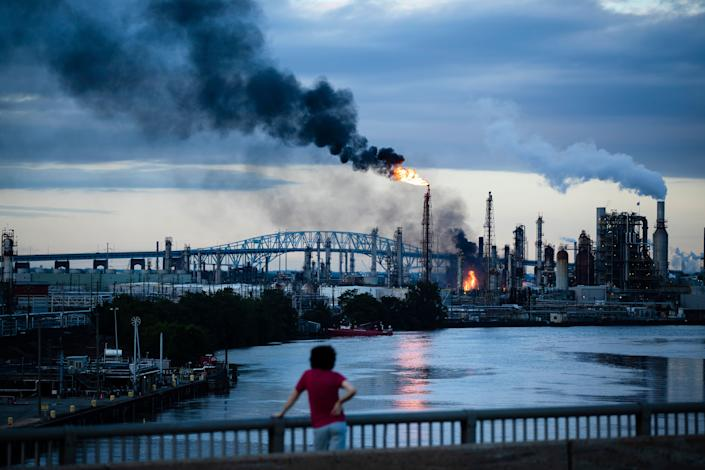 A South Philly resident watches as the Philadelphia Energy Solutions refinery goes up in flames on June 21.   (Photo: Matt Rourke/ASSOCIATED PRESS)