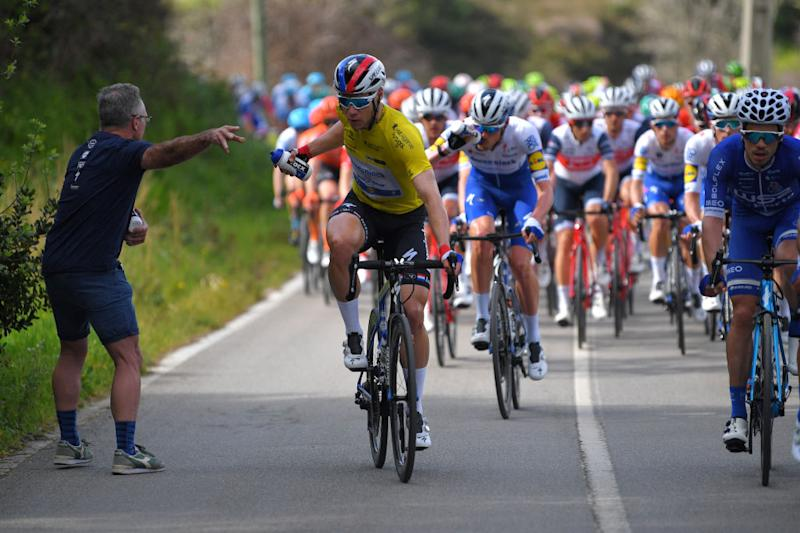 ALTO DA FIA MONCHIQUE PORTUGAL FEBRUARY 20 Fabio Jakobsen of The Netherlands and Team Deceuninck Quick Step Yellow Leader Jersey Feed Zone Tacx bottle Soigneur Peloton during the 46th Volta ao Algarve 2020 Stage 2 a 1839 km stage from Sagres Vila do Bispo to Alto da Fia 884m Monchique VAlgarve2020 on February 20 2020 in Alto da Fia Monchique Portugal Photo by Tim de WaeleGetty Images