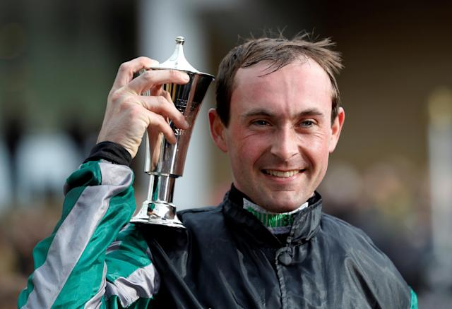 Horse Racing - Cheltenham Festival - Cheltenham Racecourse, Cheltenham, Britain - March 14, 2018 Nico de Boinville celebrates with the trophy after riding Altior to victory in the 15:30 Betway Queen Mother Champion Chase REUTERS/Darren Staples