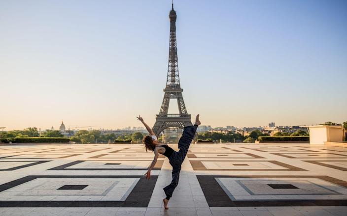 Syrian dancer and choreographer Yara al-Hasbani performs a dance on the empty Trocadero square in front of the Eiffel tower - Sameer Al-Doumy/AFP