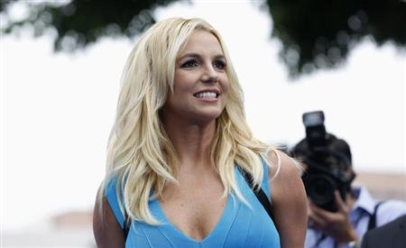 """Singer Britney Spears poses at the premiere of """"The Smurfs 2"""" at the Regency Village theatre in Los Angeles"""