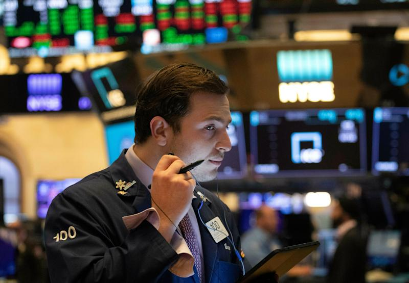 Dow tops 27,000 for the first time on easing trade tensions, prospect of lower rates
