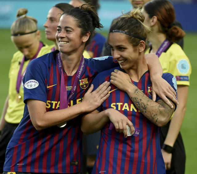 Marta Torrejon, left, and Natasha Andonova of Barcelona after their team lost to Olympique Lyon 4-1 in the women's soccer Champions League final match at the Groupama Arena in Budapest, Hungary, Saturday, May 18, 2019. (Balazs Czagany/MTI via AP)
