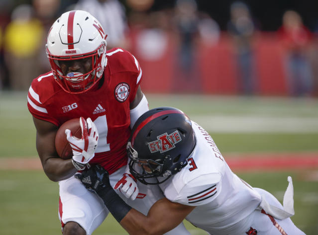 "Wide receiver <a class=""link rapid-noclick-resp"" href=""/college-football/players/275439/"" data-ylk=""slk:Tyjon Lindsey"">Tyjon Lindsey</a> (1) was one of two Nebraska players hospitalized after winter workouts. (AP Photo/Nati Harnik)"