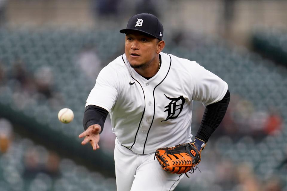 Detroit Tigers first baseman Miguel Cabrera tosses the ball to first base for an out against the Minnesota Twins in the third inning of a baseball game in Detroit, Friday, May 7, 2021.
