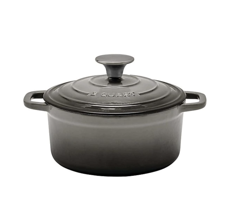 Artisanal Kitchen Supply Enameled Cast Iron Dutch Oven in Grey. Image via Bed, Bath and Beyond.
