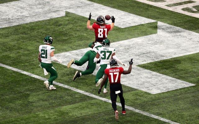 Falcons' Hayden Hurst catches the ball to score his side's second touchdown at the Tottenham Hotspur Stadium