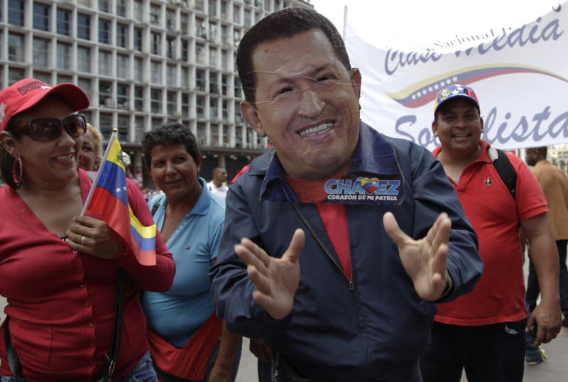 """A man wearing a handcrafted mask depicting the face of Venezuela's President Hugo Chavez attends an event commemorating the violent street protests of 1989 known as the """"Caracazo,"""" in Caracas, Venezuela, Wednesday, Feb. 27, 2013. The wave of the 1989 violent protests, seen by the Chavez government as a """"popular uprising,"""" was in response to the economic measures imposed by then President Carlos Andres Perez. (AP Photo/Ariana Cubillos)"""