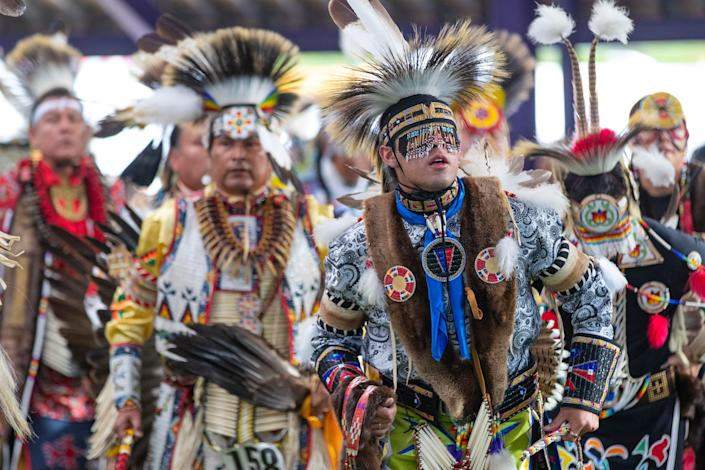 Dancers perform at the Santee Lucky Mound Pow Wow in Parshall, North Dakota. June 25, 2021