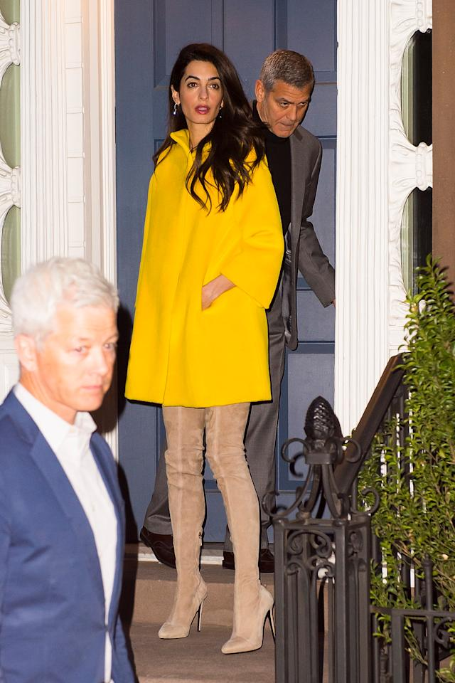 <p>Amal's canary yellow Lanvin coat and suede thigh high boots were the perfect choice for date night with actor husband, George Clooney. </p>