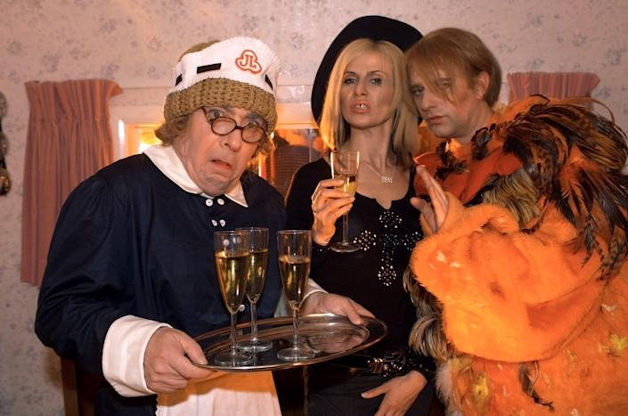 In the 2004 film spin-off of Stella Street as Mrs Huggett, cleaning lady to the stars, with Ronnie Ancona as Madonna and Phil Cornwell as David Bowie - Alamy