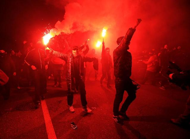 Toronto FC fans, like the ones pictured in November 2017, managed to sneak flares into the Ottawa Fury stadium, which set the TFC fans' own flags on fire when launched (AFP Photo/Vaughn Ridley)