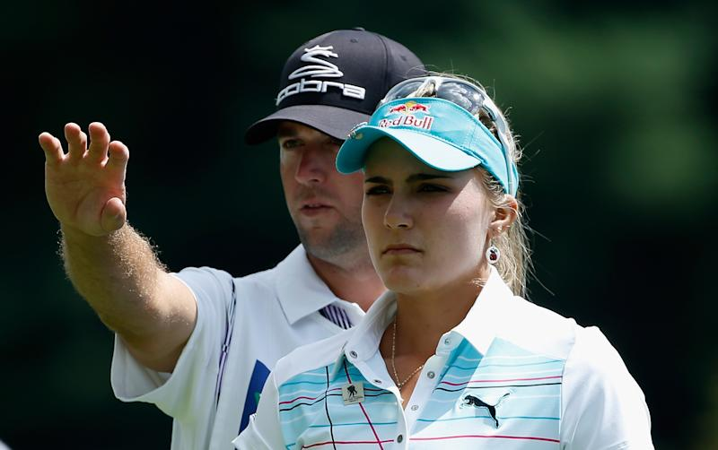 Lexi Thompson lines up a shot with her caddie Benji Thompson on the 18th hole during the first round of the Wegmans LPGA Championship, at Monroe Golf Club in Pittsford, New York, on August 14, 2014
