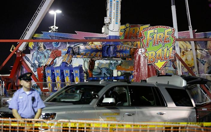 """<p>A swinging and spinning amusement park ride called the Fire Ball malfunctioned and broke apart on the opening day of the Ohio State fair on Wednesday, hurling people through the air, killing at least one and injuring seven others. Three of the injured remained in hospital in critical condition on Wednesday night, authorities said at a news conference. """"The fair is about the best things in life, and tonight with this accident it becomes a terrible, terrible tragedy,"""" said Republican Governor John Kasich. Authorities stand near damaged chairs of the Fire Ball amusement ride at the Ohio State Fair Credit: AP </p>"""