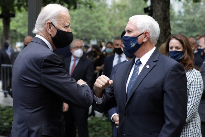 Former Vice President Joe Biden greets Vice President Mike Pence at the National September 11 Memorial & Museum in New York on Friday. (Amr Alfiky/The New York Times via AP, Pool)