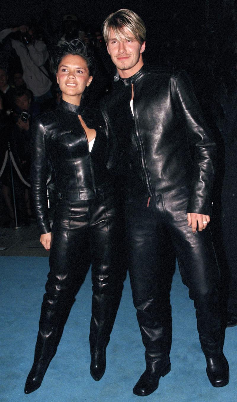Giving couples the world over style goals at 'Versace Club' gala party in matching leather boiler suits in 1999.