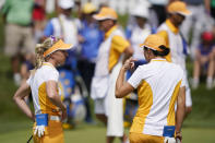 Europeans Anna Nordqvist, left, talks with Carlota Ciganda, after a practice session for the Solheim Cup golf tournament, Friday, Sept. 3, 2021, in Toledo, Ohio. (AP Photo/Carlos Osorio)