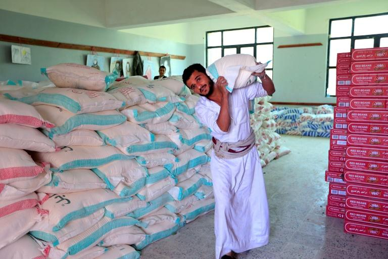 A man carries a sack of food aid in Yemen's capital Sanaa (AFP Photo/MOHAMMED HUWAIS)