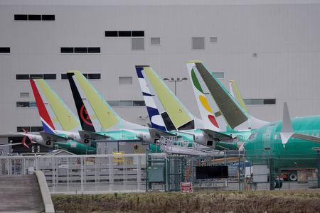 FILE PHOTO: The tails of Boeing 737 MAX aircraft are seen at a Boeing production facility in Renton, Washington