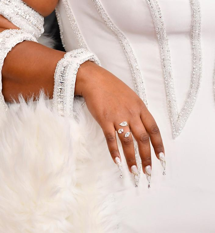Lizzo's bejeweled nails at the Grammys. (Photo: Frazer Harrison via Getty Images)