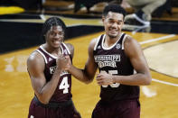 Mississippi State guard Cameron Matthews (4) and forward Tolu Smith (35) celebrate after a win over Vanderbilt in an NCAA college basketball game Saturday, Jan. 9, 2021, in Nashville, Tenn. (AP Photo/Mark Humphrey)