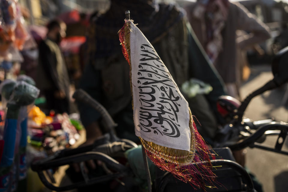 A Taliban flag is placed in the front of a motorbike in Kabul, Afghanistan, Tuesday, Sept. 28, 2021. (AP Photo/Bernat Armangue)