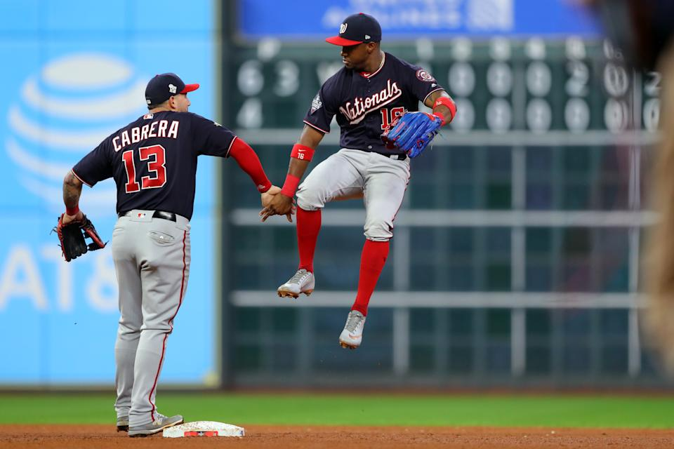 HOUSTON, TX - OCTOBER 29: Asdrubal Cabrera #13 and Victor Robles #16 of the Washington Nationals celebrate after the Nationals defeat the Houston Astros in Game 6 of the 2019 World Series at Minute Maid Park on Tuesday, October 29, 2019 in Houston, Texas. (Photo by Alex Trautwig/MLB Photos via Getty Images)