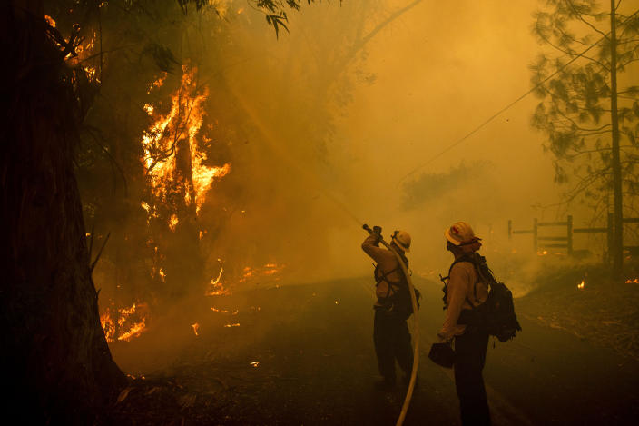 Firefighters battle a wildfire called the Kincade Fire on Chalk Hill Road in Healdsburg, Calif., Sunday, Oct. 27, 2019. (Photo: Noah Berger/AP)