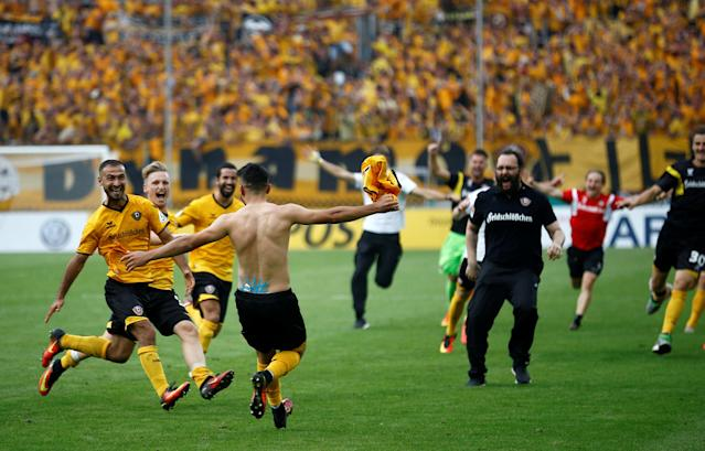 Football Soccer - Dynamo Dresden v RB Leipzig - German Cup (DFB Pokal) - DDV-Stadion, Dresden, Germany - 20/08/16. Dynamo Dresden's Aias Aosman (front) and his team mates celebrate after he scored the final penalty. REUTERS/Axel Schmidt. DFB RULES PROHIBIT USE IN MMS SERVICES VIA HANDHELD DEVICES UNTIL TWO HOURS AFTER A MATCH AND ANY USAGE ON INTERNET OR ONLINE MEDIA SIMULATING VIDEO FOOTAGE DURING THE MATCH.
