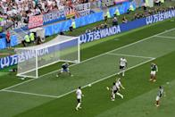 <p>Hirving Lozano of Mexico scores his team's first goal under pressure from Toni Kroos of Germany during the 2018 FIFA World Cup Russia group F match between Germany and Mexico at Luzhniki Stadium on June 17, 2018 in Moscow, Russia. (Photo by Dan Mullan/REMOTE/Getty Images) </p>