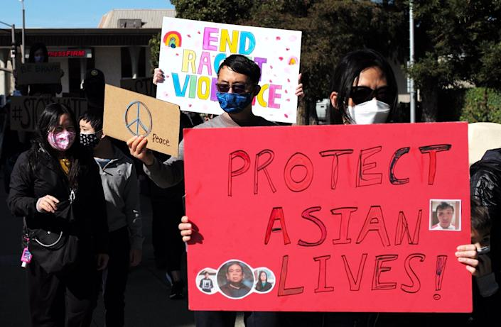 Demonstrators rally against anti-Asian hate crimes in San Mateo, California, on Feb. 27. (Photo: Xinhua News Agency/Getty Images)